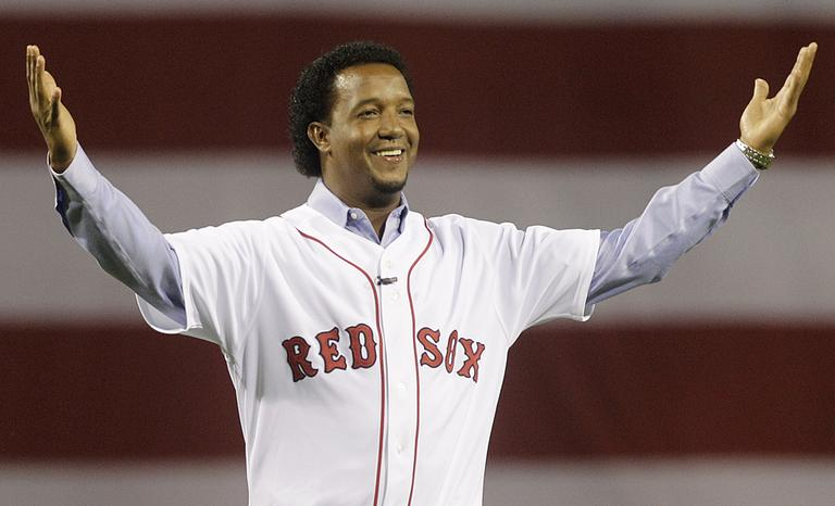 Former Red Sox pitcher Pedro Martinez greets the crowd before throwing the ceremonial first pitch before the opening game of the 2010 season. (Elise Amendola/AP)