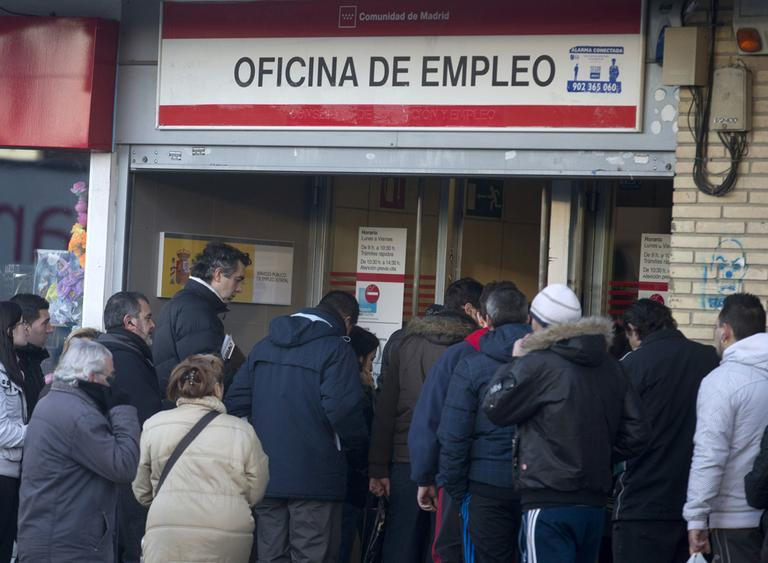People queue to enter an unemployment registry office in Madrid, on Thursday Jan. 24, 2013. Spain's unemployment rate shot up to a record 26 percent in the fourth quarter of 2012, leaving almost million people now out of work. (Paul White/AP)