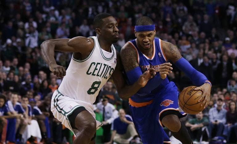 New York Knicks shooting guard James White (4) drives against Boston Celtics power forward Jeff Green (Charles Krupa/AP)