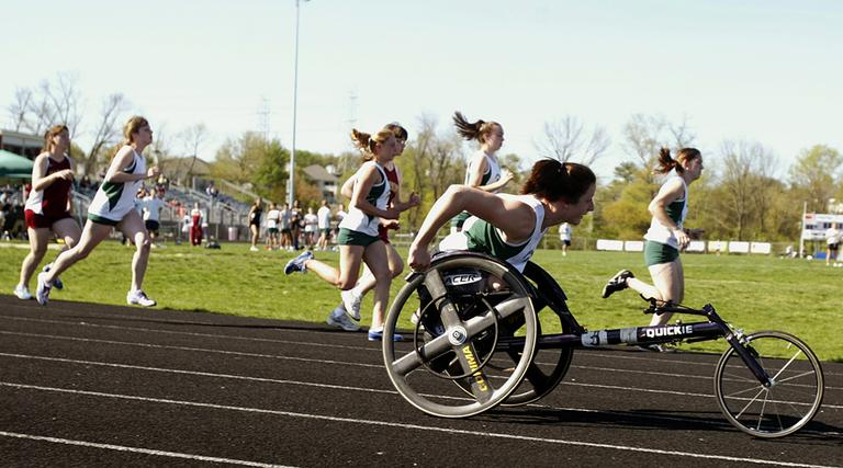 Wheelchair athlete Tatyana McFadden, front, races in her first high school track meet alongside able-bodied runners in April 2006 in Rockville, Md. McFadden sued the county school system in federal court in Baltimore for the right to race at the same time as able-bodied athletes. She had been forced to compete in separate wheelchair events, usually by herself. (Chris Gardner/AP)