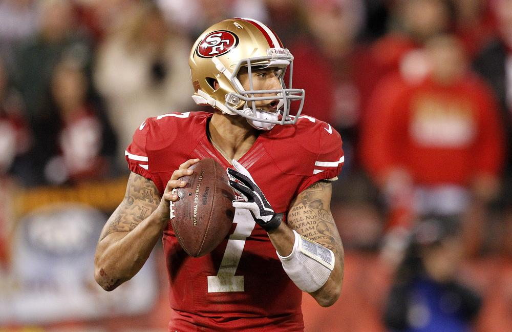 San Francisco quarterback Colin Kaepernick's famous biceps are likely to get even more famous with a trip to the Super Bowl. (Tony Avelar/AP)