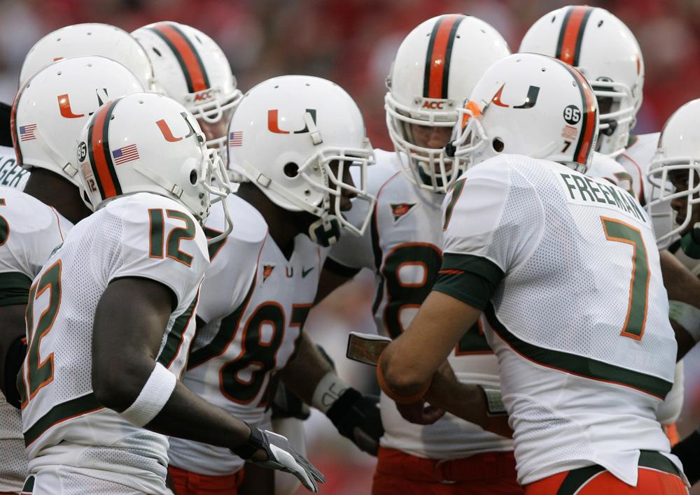 The NCAA has put on hold its own investigation into a University of Miami booster's relationship with the Hurricanes athletic department because investigators violated NCAA rules. (Chris Gardner/AP)