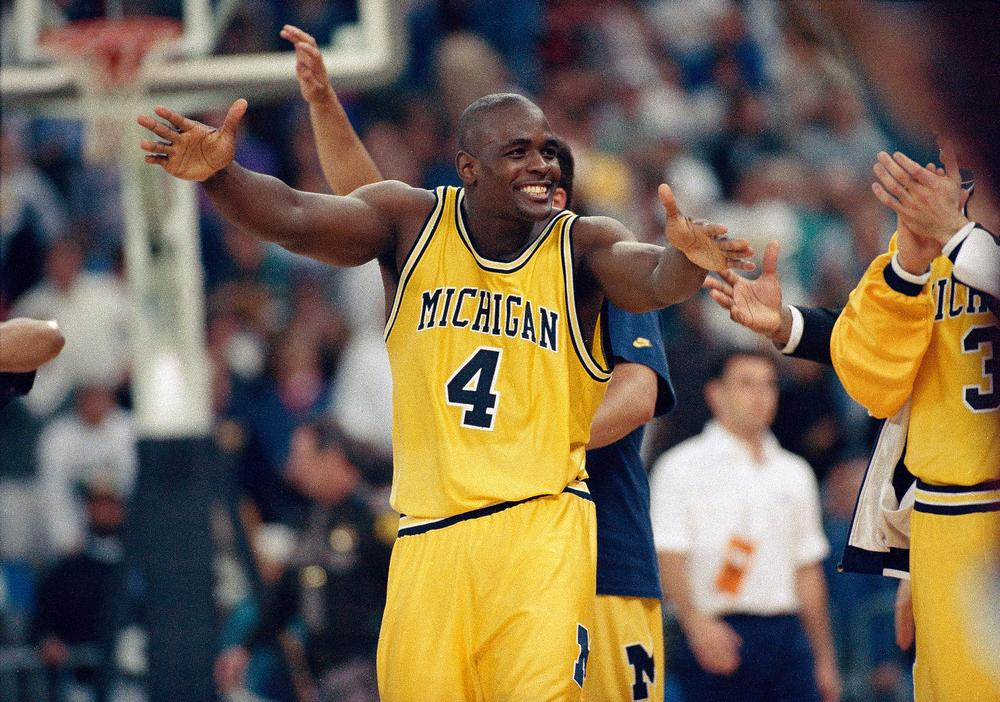 Chris Webber is just one of a number of former college athletes to be involved in a scandal. In hisbook 'Cheating the Spread,' Albert Figonelooks at the less flattering side of college athletics.(Susan Ragan/AP)