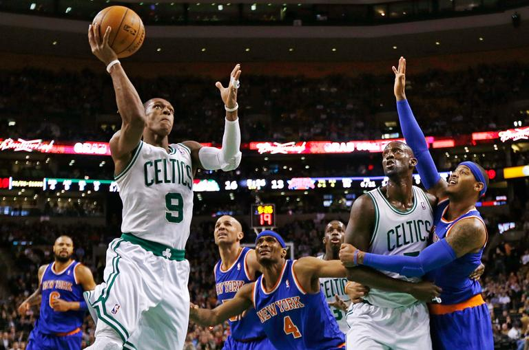 Boston Celtics guard Rajon Rondo (9) drives to the basket as Kevin Garnett blocks out New York Knicks forward Carmelo Anthony, right, during the first quarter of an NBA basketball game in Boston, Thursday, Jan. 24, 2013. (Charles Krupa/AP)