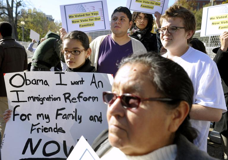 Diana Saravia, 10, of Beltsville, Md., left, demonstrates, along with members of immigration rights organizations, in front of the White House in November 2012. The demonstrators called on President Obama to fulfill his promise of passing comprehensive immigration reform. (Cliff Owen/AP)