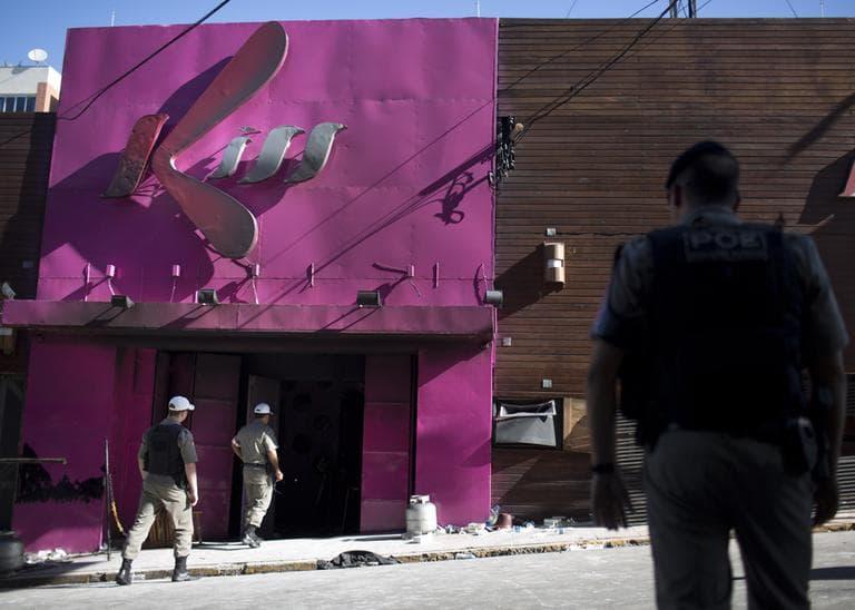 Police officers enter the Kiss nightclub in Santa Maria city, Rio Grande do Sul state, Brazil, Monday, Jan. 28, 2013. (Felipe Dana/AP)