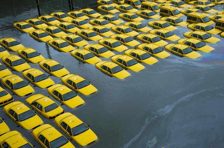 A parking lot full of yellow cabs is flooded as a result of superstorm Sandy on Tuesday, Oct. 30, 2012 in Hoboken, NJ. (AP)