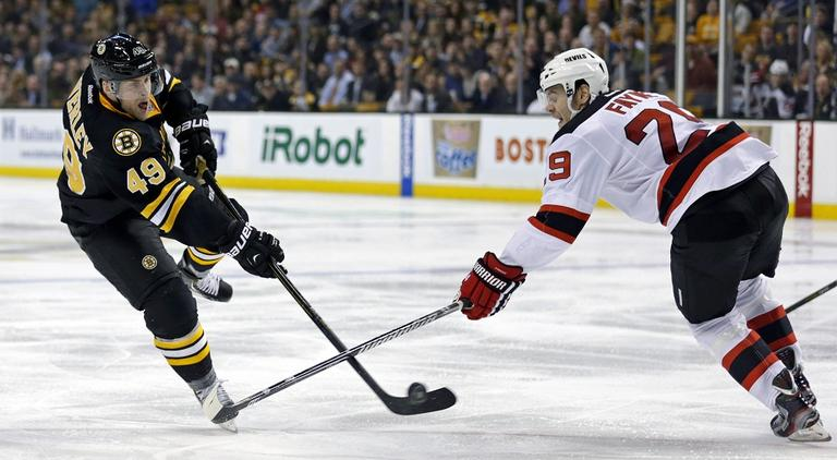 Bruins center Rich Peverley (49) shoots as New Jersey Devils defenseman Mark Fayne (29) tries to block. (Charles Krupa/AP)