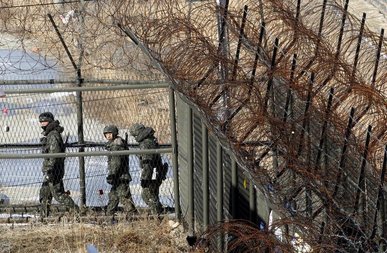 South Korean army soldiers patrol along the barbed-wire fence at the Imjingak Pavilion, South Korea, near the demilitarized zone (DMZ) of Panmunjom on Saturday. (Ahn Young-joon/AP)