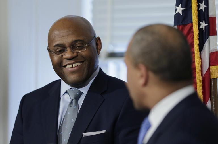 "William ""Mo"" Cowan, left, with Gov. Patrick during a news conference where he was named interim U.S. Senator for the seat vacated with the resignation of Sen. John Kerry. (Charles Krupa/AP)"
