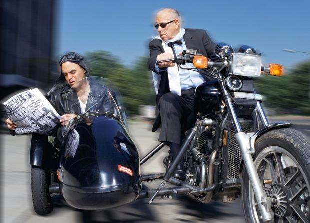 """""""Wait Wait's"""" Peter Sagal and Carl Kasell demonstrate the dangers of multitasking. (©2004 NPR Photo by Tony Nagelmann)"""