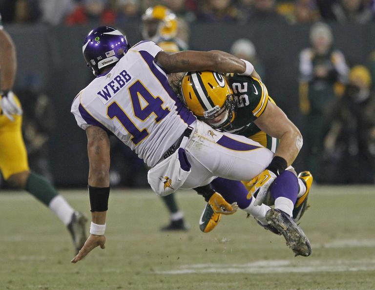 Green Bay Packers outside linebacker Clay Matthews hits Minnesota Vikings quarterback Joe Webb after throwing a pass during an NFL wild card playoff football game Saturday, Jan. 5, 2013, in Green Bay, Wis. (AP Photo/Matt Ludtke)