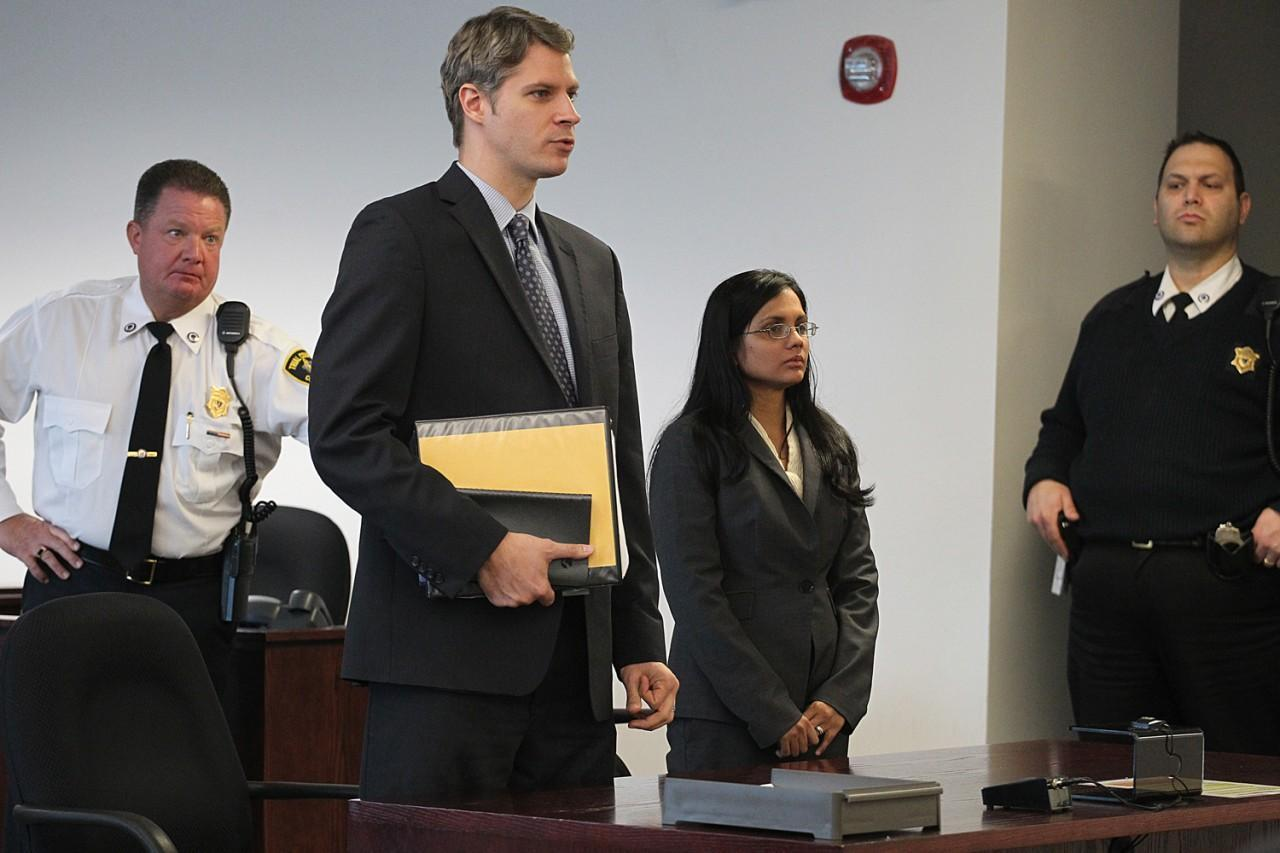 Former state lab chemist Annie Dookhan, second from right, stands in Middlesex Superior Court for arraignment on Wednesday, Jan. 9, 2013, with her attorney Nick Gordon, second left, in Woburn, Mass.(AP)
