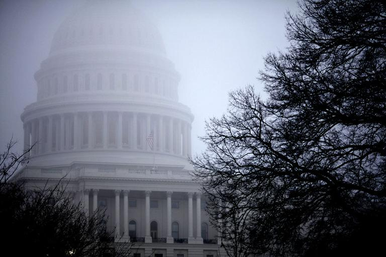 Fog obscures the Capitol dome on Capitol Hill in Washington. (AP)
