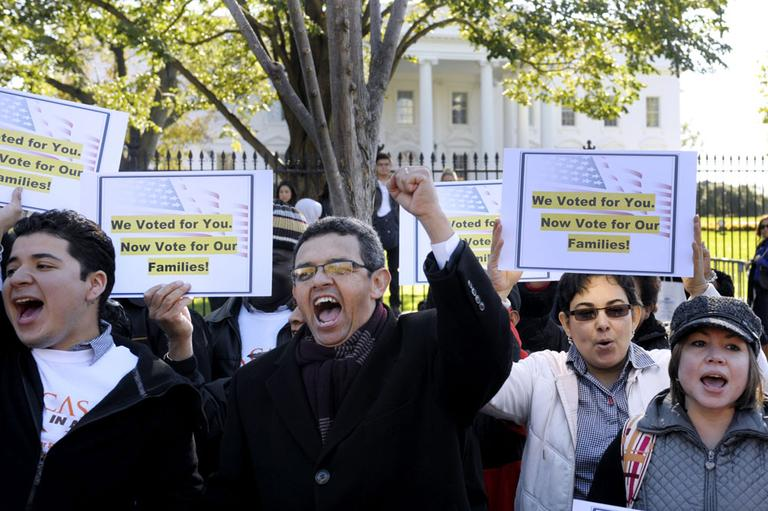 Gustavo Torres, director, Casa in Action, center, and others, chant during a rally of immigration rights organizations, including Casa in Action and Maryland Dream Act, in front of the White House in Washington, Thursday, Nov. 8, 2012. (AP)