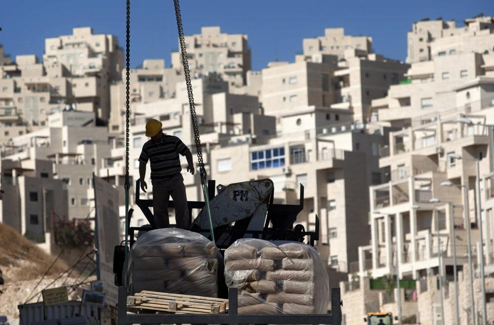 In this Nov. 2, 2011 file photo, a construction worker works on a new housing unit in the east Jerusalem neighborhood of Har Homa. (AP)