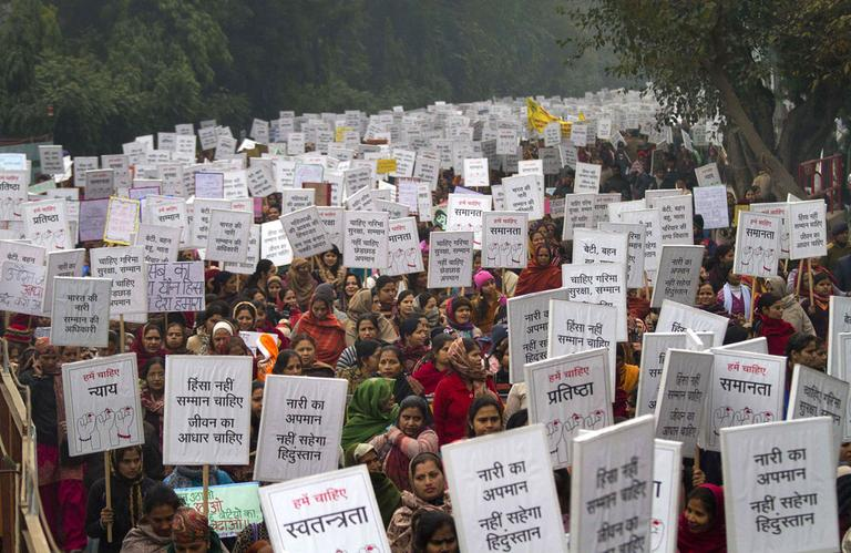 Indian women carry placards as they march to mourn the death of a gang rape victim in New Delhi, India, Wednesday, Jan. 2, 2013. (AP)