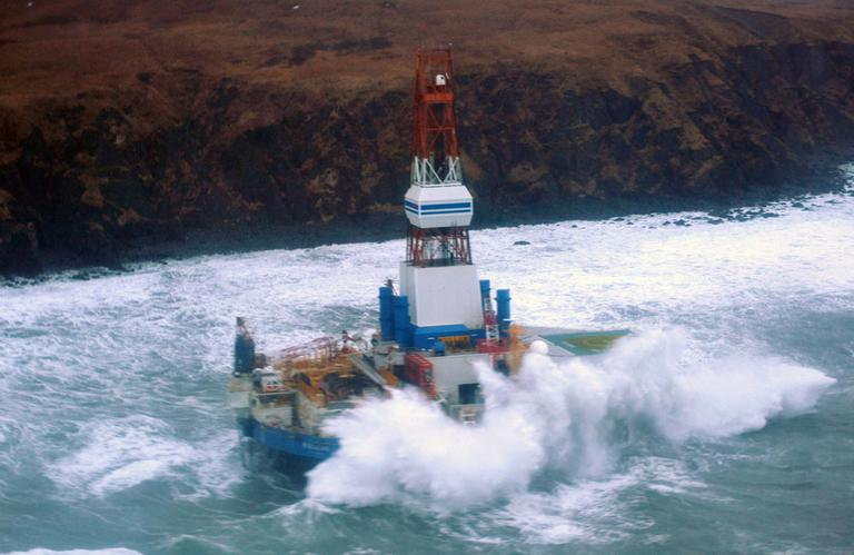 This image provided by the U.S. Coast Guard shows the Royal Dutch Shell drilling rig Kulluk aground off a small island near Kodiak Island Tuesday Jan. 1, 2013. (AP/Coast Guard)