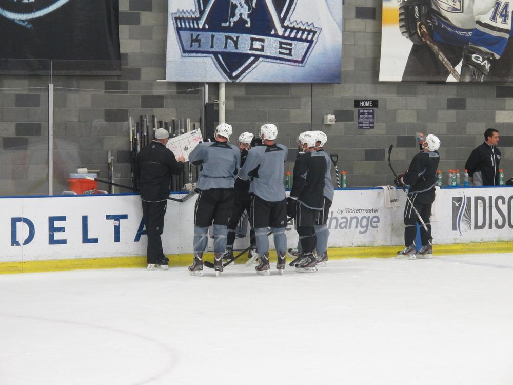 Kings Assistant Coach Davis Payne goes over drills with one of the lines at Kings training camp. (Susan Valot/Only A Game)