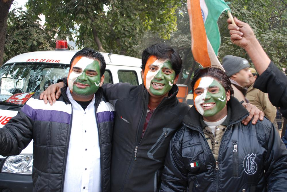 Fans in Delhi with a hybrid of Indian and Pakistani flags painted on their faces. (Ken Shulman/Only A Game)