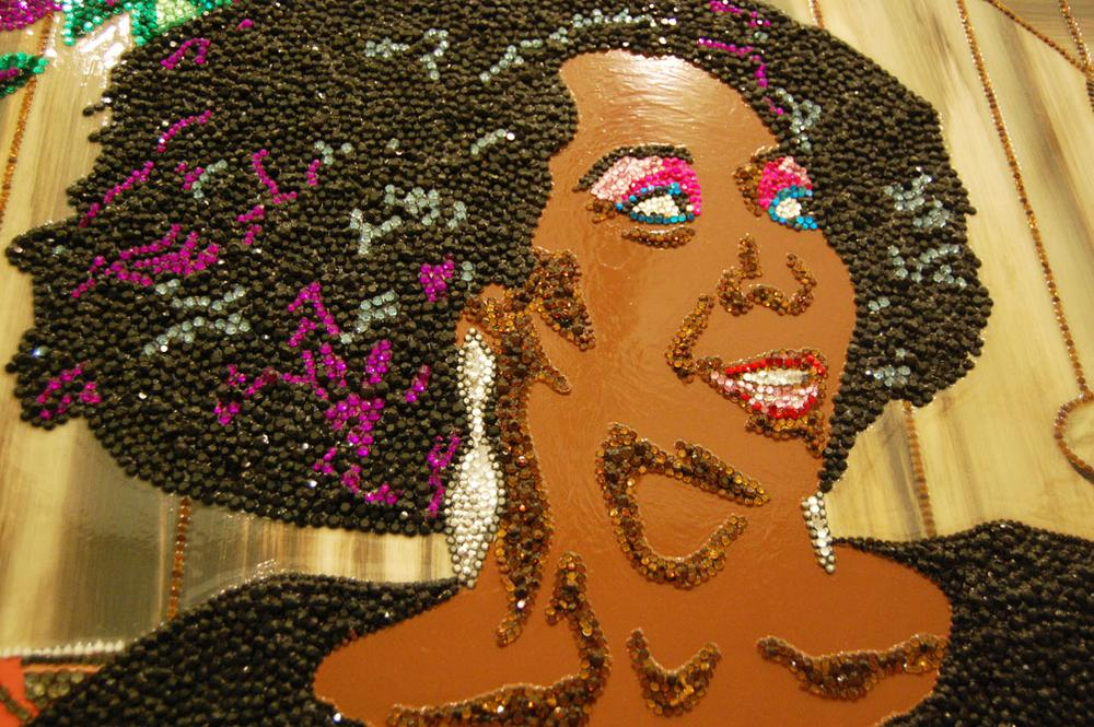 """A close up of the rhinestone-encrusted surface of Mickalene Thomas's 2009 portrait of her mother, """"Sandra: She's a Beauty."""" (Greg Cook)"""
