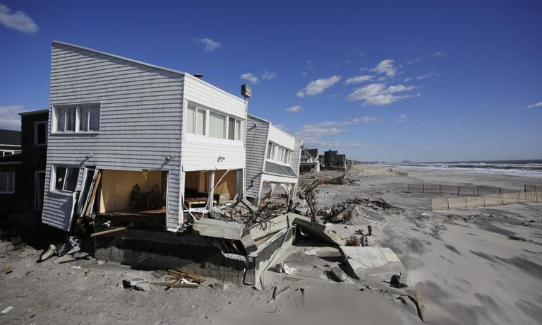 Storm-damaged beachfront houses are shown in the Far Rockaways, Jan. 31, 2013 in the Queens borough of New York, three months after Superstorm Sandy. (Mark Lennihan/AP)