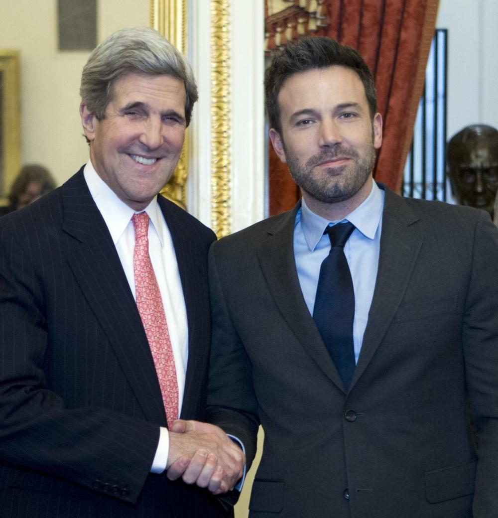 U.S. Sec. of State and then-Sen. John Kerry shakes hands with Affleck in Washington on Wednesday, Dec. 19, 2012. (Jose Luis Magana/AP)