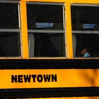 A boy sits on a Newtown bus leaving the new Sandy Hook Elementary School after the first day of classes in Monroe, Conn., Thursday, Jan. 3, 2013.  The former Chalk Hill School was renamed Sandy Hook Elementary and overhauled especially for the students from the Sandy Hook School shooting. (Jessica Hill/AP)