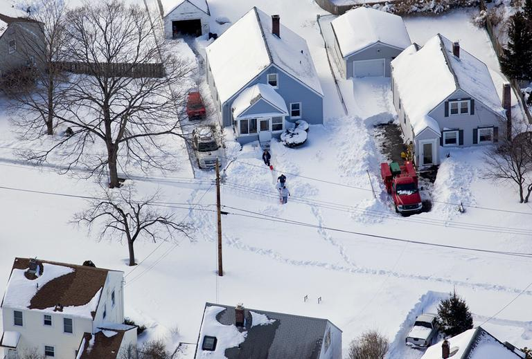 People dig out in front of a snow covered home near Hamden, Conn., Sunday, Feb. 10, 2013, in the aftermath of a storm that hit Connecticut and much of the New England states. (Craig Ruttle/AP)