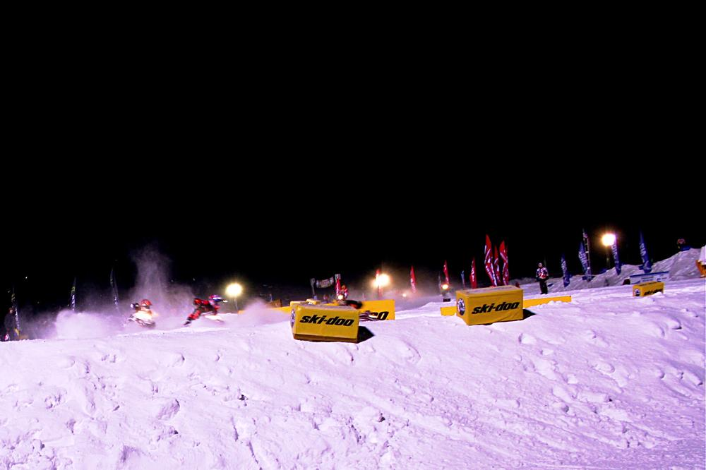 Snowmobile racers enter a sharp turn at a competition in Michigan last weekend. (Neal Steeno/Only A Game)
