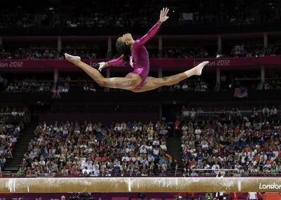 Gabby Douglas captured gold at the 2012 Olympics in London, making her the youngest African-American medalist. (Gregory Bull/AP)