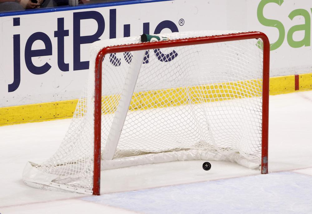 A high school goalie from Farmington, Minn. turned heads earlier this weekwhen he purposefully scored on his team's goal in the third period. (Wilfredo Lee/AP)