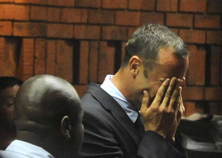 South African Paralympic and Olympic sprinter Oscar Pistorius wept in court Friday while being charged with his girlfriend's murder. (Antione de Ras/Independent Newspapers Ltd South Africa/AP)