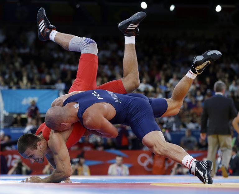 If the decision of the IOC Executive Board stands, wrestling will appear for the last time at the 2016 Olympics. (Paul Sancya/AP)