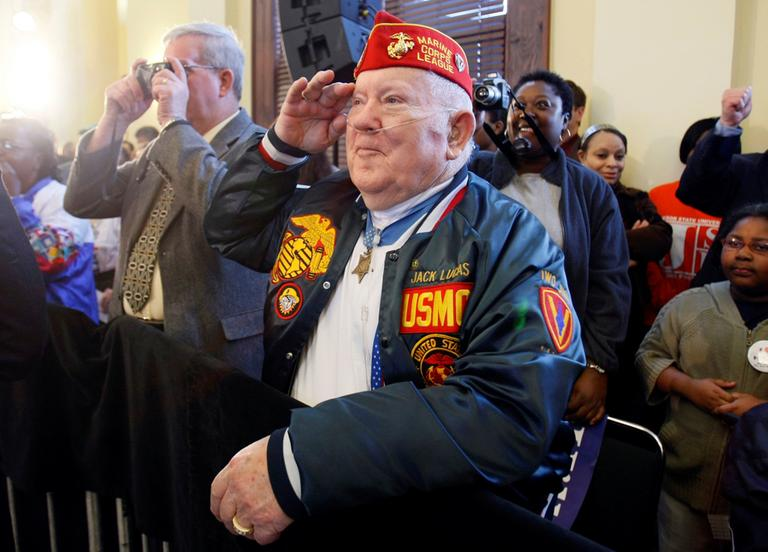 Medal of Honor recipient Jack Lucas, 80, salutes Democratic presidential hopeful Sen. Hillary Rodham Clinton, D-N.Y., as she acknowledges him during a campaign stop at the train depot in Hattiesburg, Miss, on March 7, 2008. (Carolyn Kaster/AP)