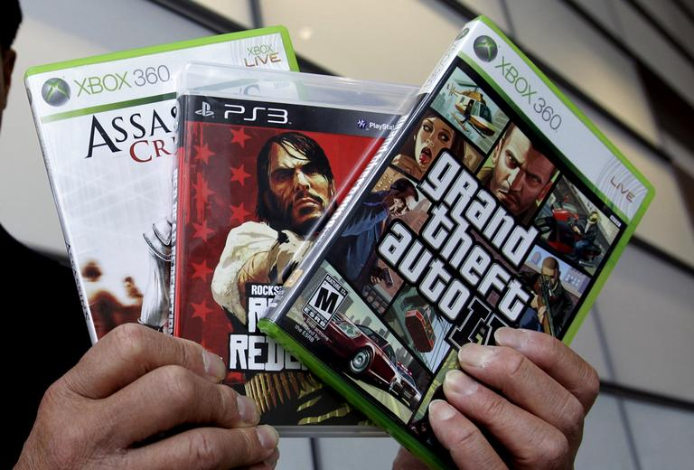 Calif. State Sen. Leland Yee holds up three video games after a news conference following the 2011 Supreme Court ruling that it is unconstitutional to bar children from buying or renting violent video games. (Paul Sakuma/AP)