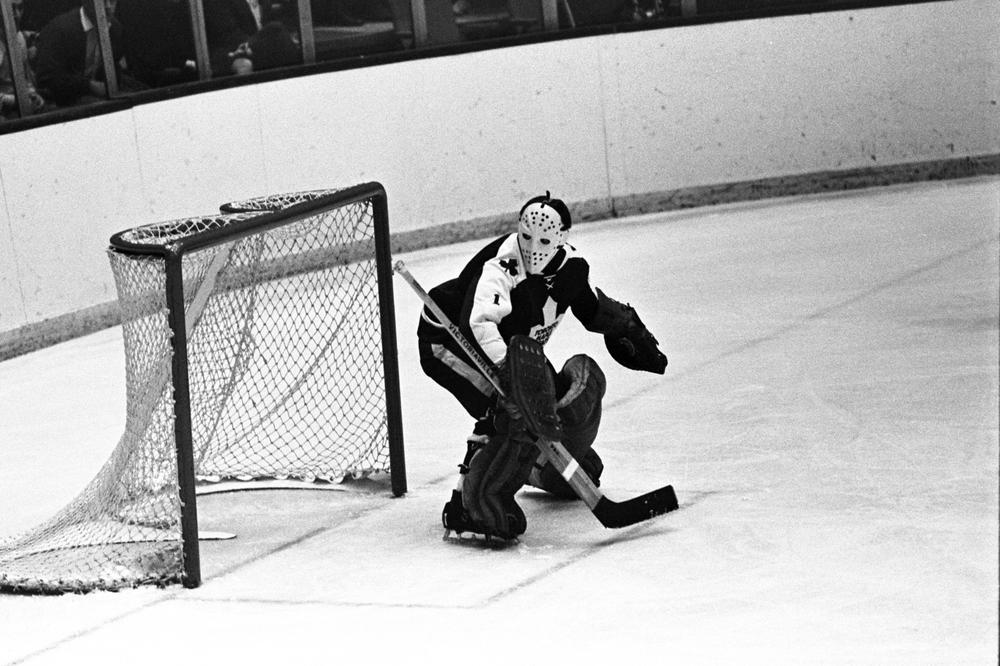Larry Kwong, the first man of Chinese descent to play in the NHL, shared the ice with hockey greats like Jacques Plante (above) while playing on farm-league teams in Canada. (Harry Cabluck/AP)