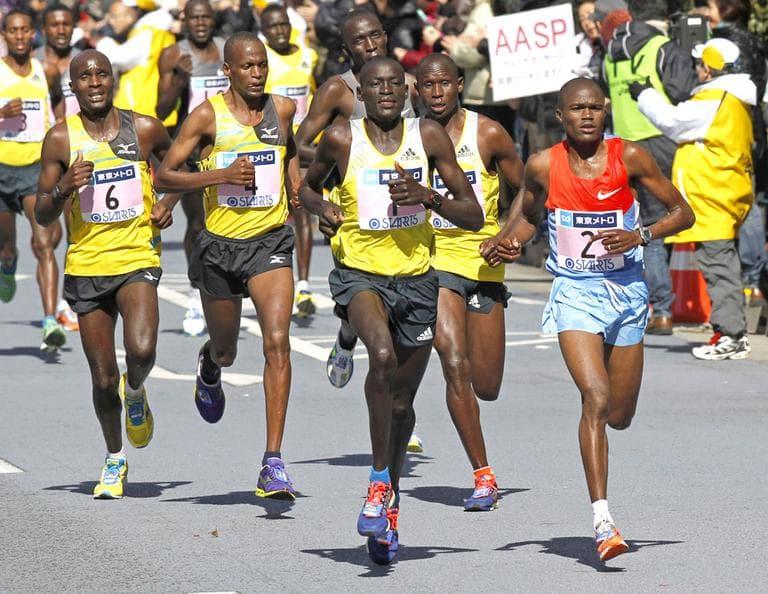 Dennis Kimetto of Kenya, center, leads the pack on his way to winning the men's race of the Tokyo Marathon on Sunday. (AP/Shuji Kajiyama)