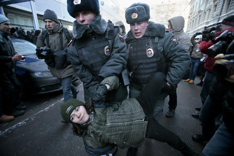Police detain a gay rights activist during a protest near the State Duma, Russia's lower parliament chamber, in Moscow, Russia, Friday, Jan. 25, 2013. (Mikhail Metzel/AP)