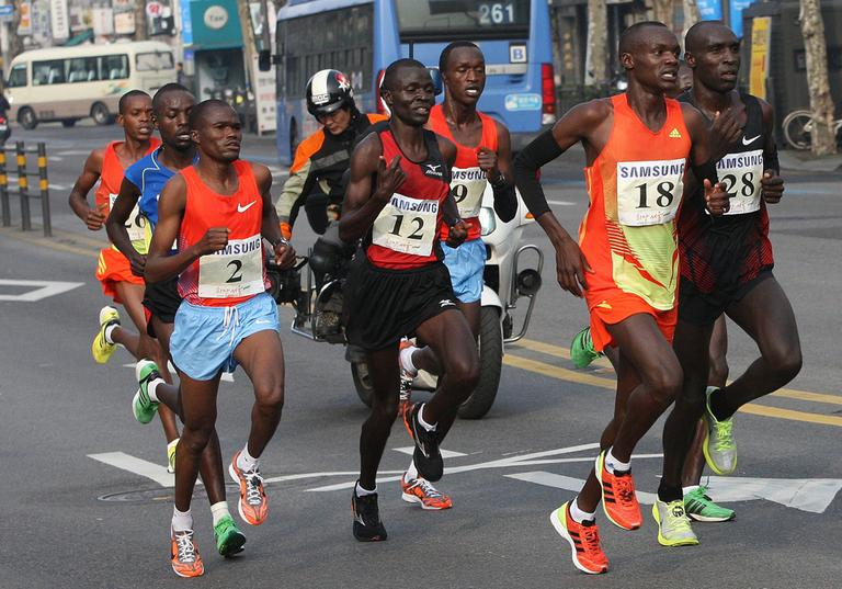 Wilson Loyanae Erupe of Kenya (18) is seen leading a pack of runners during the men's race of the Seoul International Marathon in Seoul, South Korea, March 18, 2012. Erupe, who won that race, is among three Kenyan runners suspended in February 2013 for doping. (Ahn Young-joon/AP)