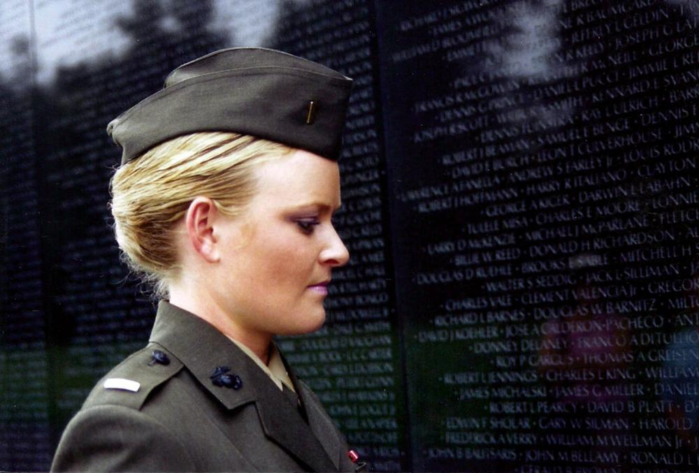 Lieutenant Elle Helmer at the Vietnam War Memorial, US Marine Corps, from THE INVISIBLE WAR, a Cinedigm/Docurama Films release.