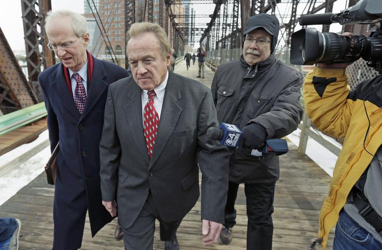 Michael McLaughlin, the former director of the Chelsea, Mass. Housing Authority, center, walks with his lawyer Thomas Hoopes, left, as they leave U.S. District Court in Boston, Tuesday, Feb. 19, 2013. McLaughlin pleaded guilty to four federal counts of falsely reporting his salary. He entered a guilty plea and will be sentenced on May 14th. (AP Photo/Charles Krupa)