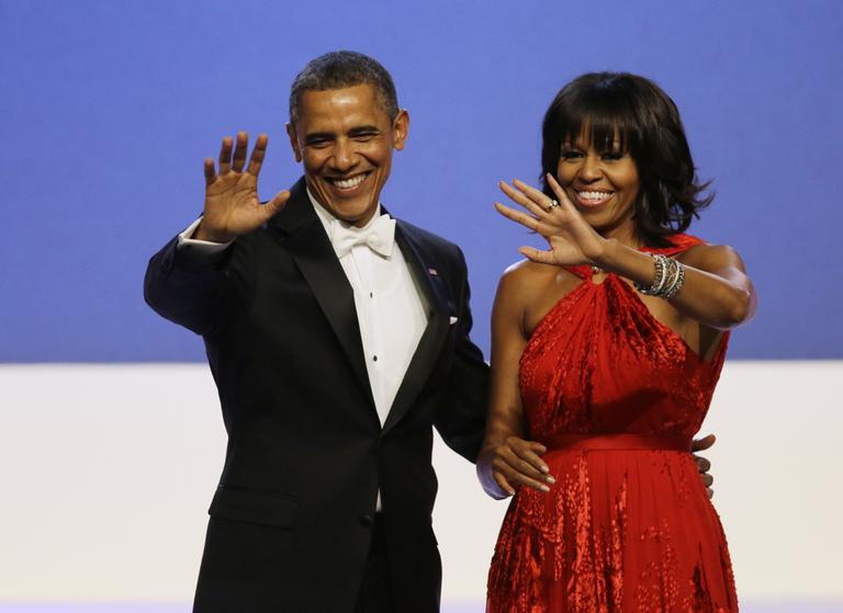 President Barack Obama and Michelle Obama wave to guests after their dance at the Inaugural Ball at the 57th Presidential Inauguration in Washington in January. (Paul Sancya/AP)