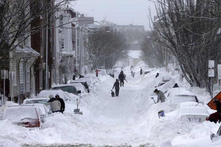 Residents on Second street in the South Boston neighborhood of Boston begin shoveling out their cars Saturday, Feb. 9, 2013 in Boston. (AP Photo/Gene J. Puskar)