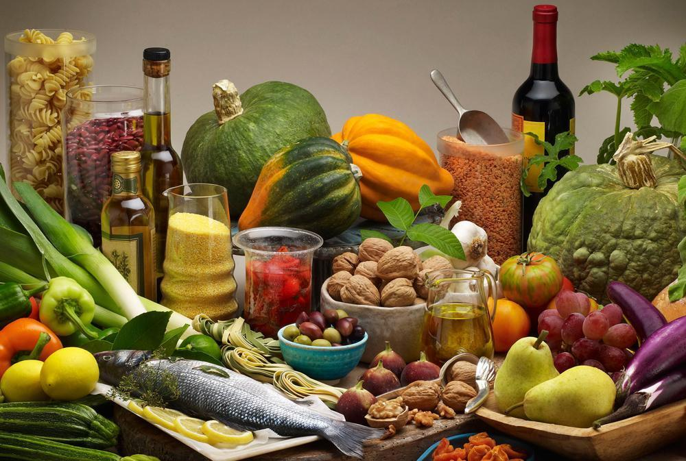 A new study confirms that the so-called Mediterranean Diet - a diet rich in olive oil, legumes, nuts, fish, fresh fruits and vegetables and wine - sharply reduces risk of heart attack, stroke and death from heart disease. (California Walnut Commission/AP)