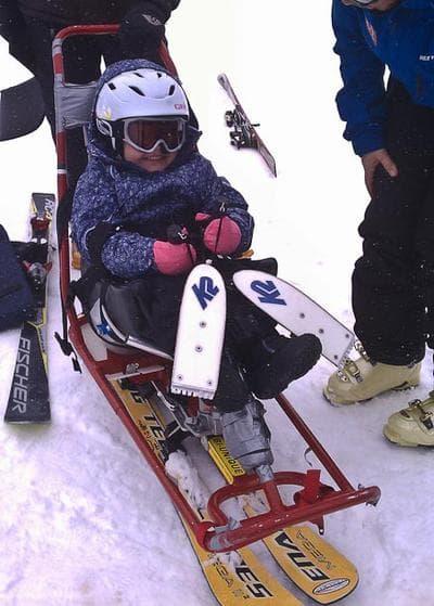 Emmy Pfankuch smiled big as she learned to sit-ski a few years back. (Jill Pfankuch)