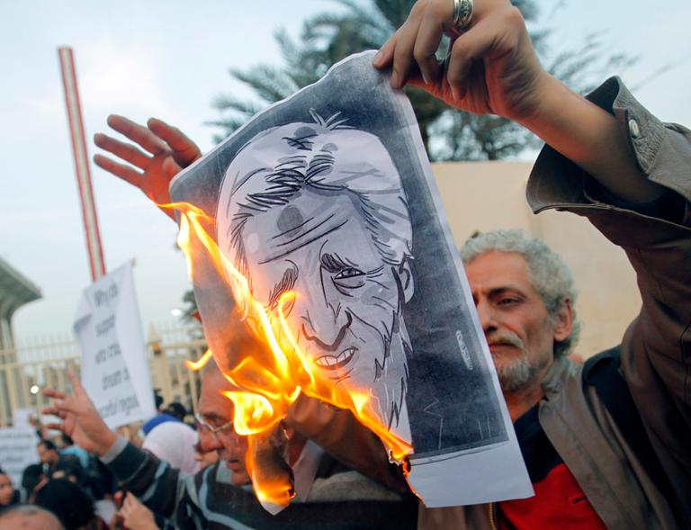 Egyptian activists burn a poster depicting U.S. Secretary of State John Kerry during a protest outside the Egyptian foreign ministry in Cairo, Egypt, Saturday, March 2, 2013. (Amr Nabil/AP)