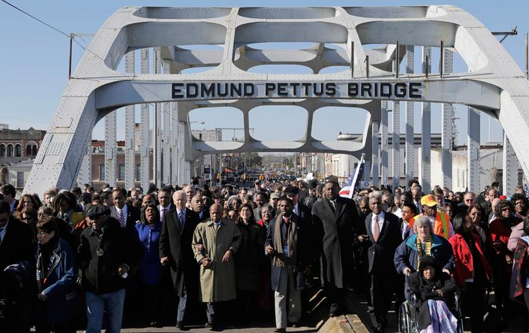 Vice President Joe Biden and U.S. Rep. John Lewis, D-Ga., lead a group across the Edmund Pettus Bridge in Selma, Ala. on Sunday. They were commemorating the 48th anniversary of Bloody Sunday, when police officers beat marchers when they crossed the bridge on a march from Selma to Montgomery.(Dave Martin/AP)