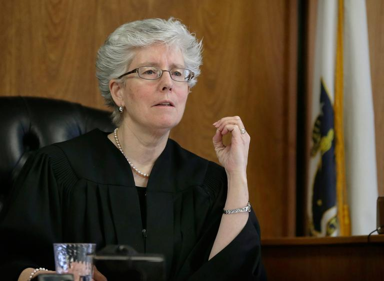 Judge Marianne Hinkle listens to an attorney in her courtroom at Woburn District Court in Woburn, Mass., Friday, March 1, 2013. Every judge in the Mass. is required to spend one week every nine months handling calls at night and on weekends. (Elise Amendola/AP)