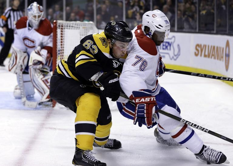 Boston Bruins left wing Brad Marchand (63), center, keeps pressure on Montreal Canadiens defenseman P.K. Subban. (Steven Senne/AP)